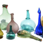 A selection of Late Persian Glass, including saddle flasks, karabas, rose water bottles and other forms.